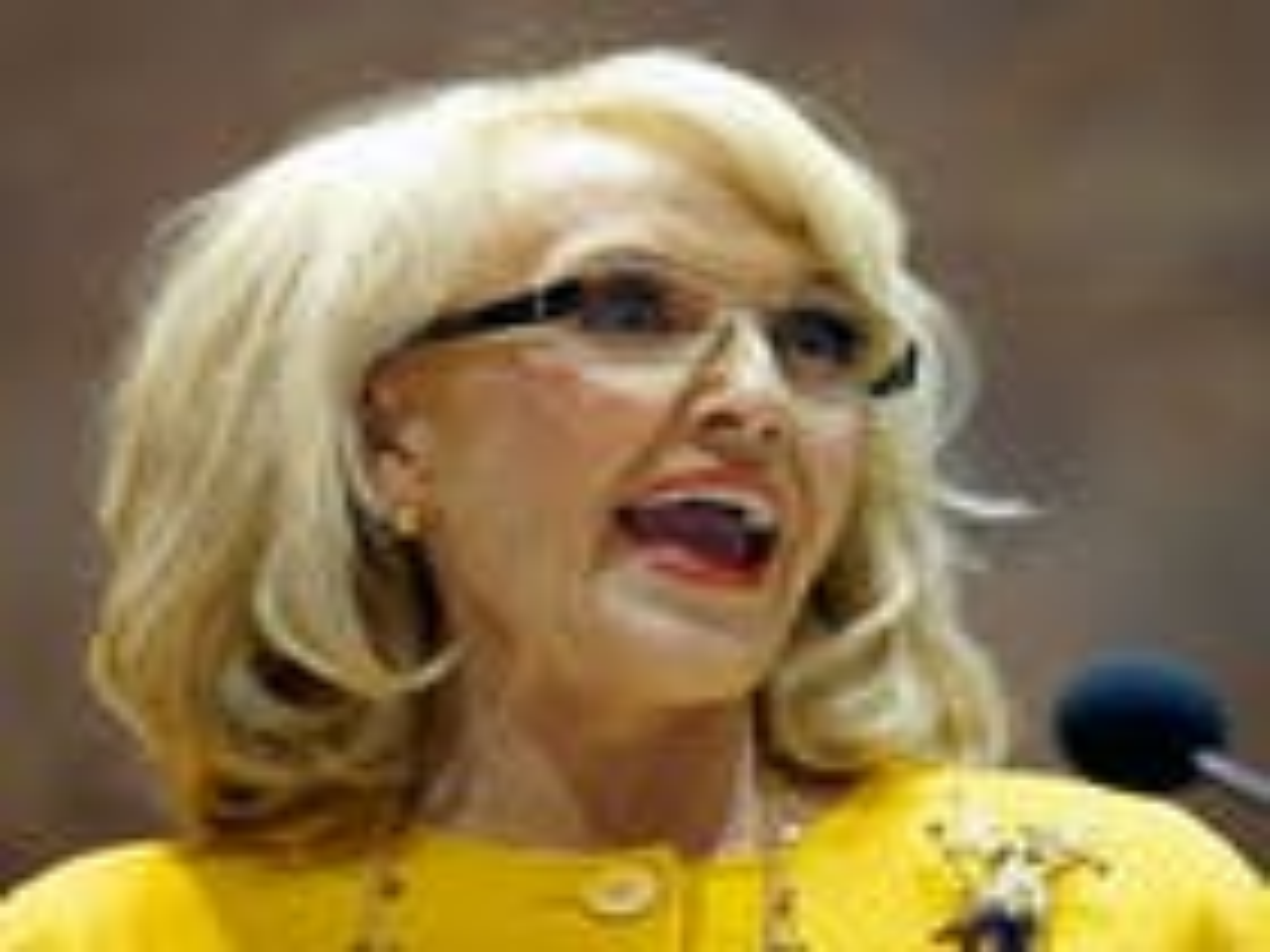 Ariz. governor returns home amid furor over anti-gay religious freedom bill
